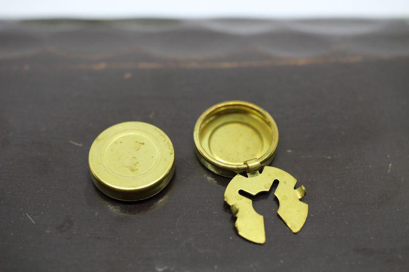 Cache bouton